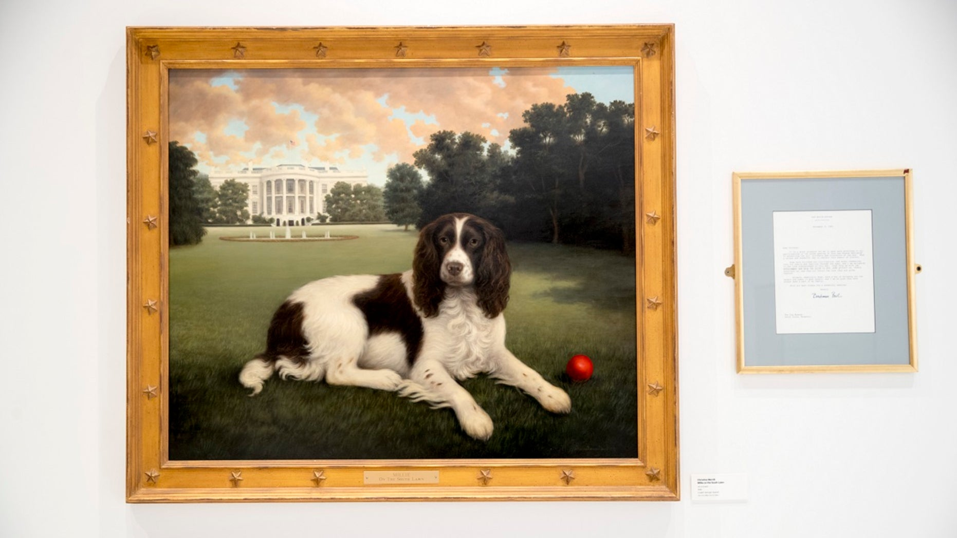 """""""Millie on the South Lawn"""" by Christine Merrill, alongside a letter from the late former first lady Barbara Bush, ondisplay at the American Kennel Club Museum of the Dog in New York City, Jan. 9, 2019. The museum opens Feb. 8. (Associated Press)"""