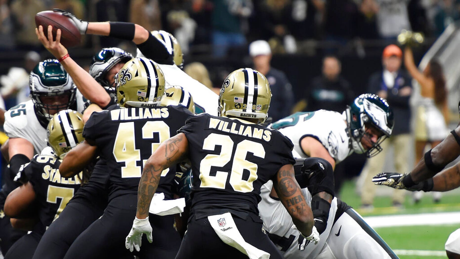 Philadelphia Eagles quarterback Nick Foles (9) leaps into a finish section for touchdown in a initial half of an NFL local playoff football diversion opposite a Philadelphia Eagles in New Orleans, Sunday, Jan. 13, 2019. (AP Photo/Bill Feig)
