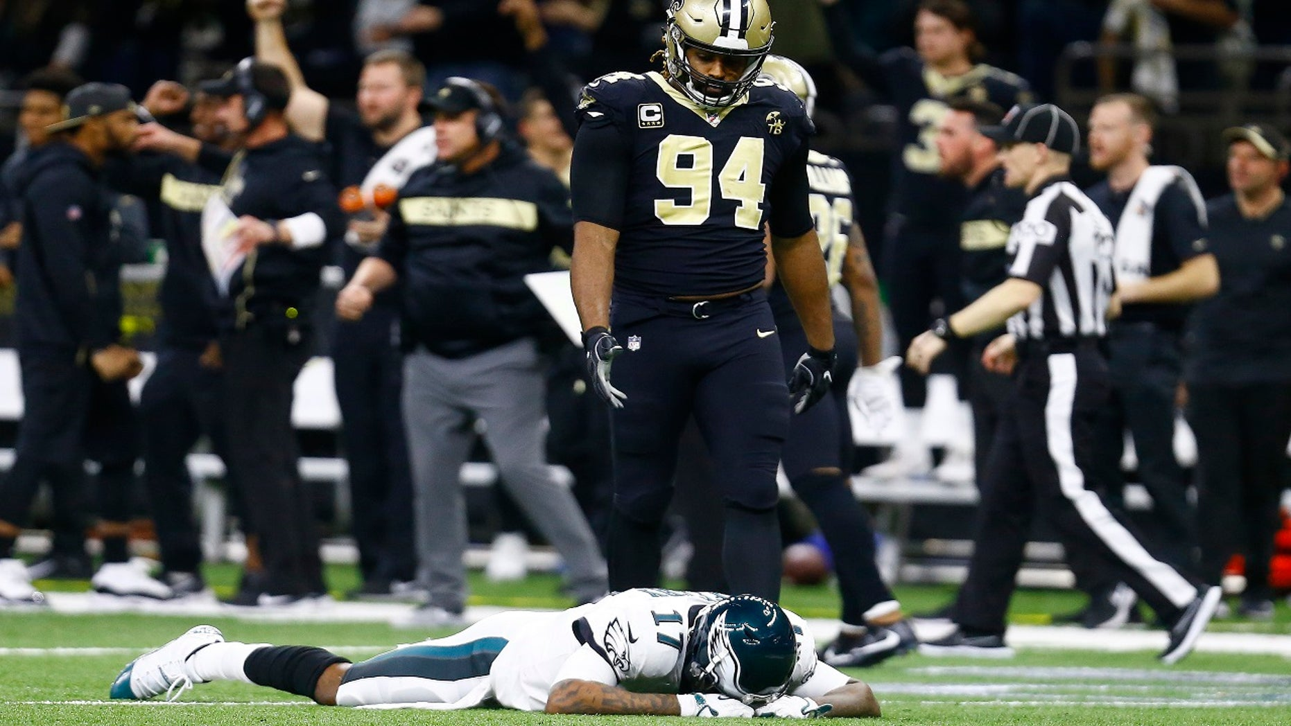 Philadelphia Eagles wide receiver Alshon Jeffery (17) lies on the turf in front of New Orleans Saints defensive end Cameron Jordan (94) after the Saints intercepted a pass in the second half of an NFL divisional playoff football game in New Orleans, Sunday, Jan. 13, 2019. The Saints won 20-14.(Associated Press)