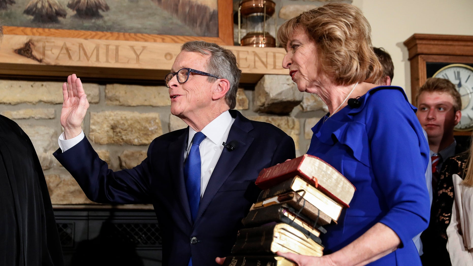 Mike DeWine is sworn in as the 70th Governor of Ohio alongside his wife Fran, Monday, Jan. 14, 2019, in Cedarville, Ohio. The former U.S. senator took his oath in a private midnight ceremony at his Cedarville home ahead of a public inauguration Monday at the Statehouse.