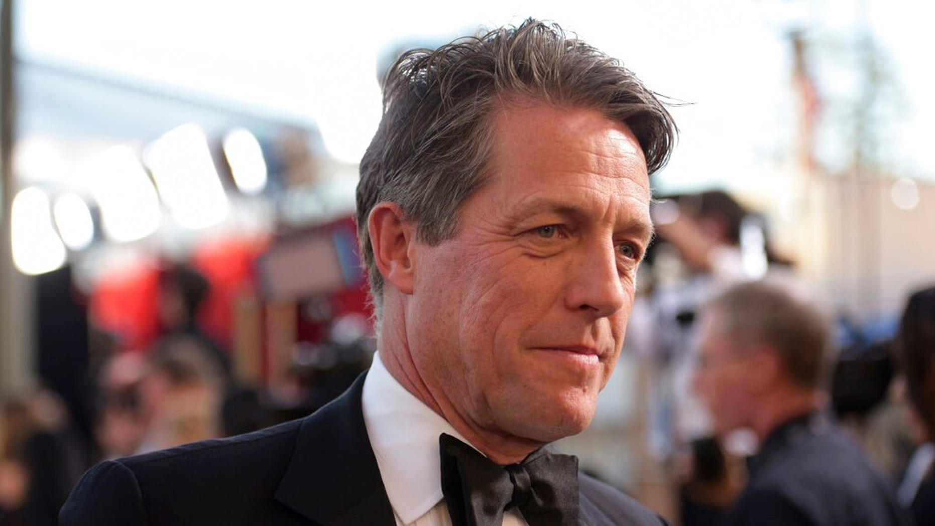British actor Hugh Grant tweeted a plea to the thief who broke into his vehicle tiring Sunday.