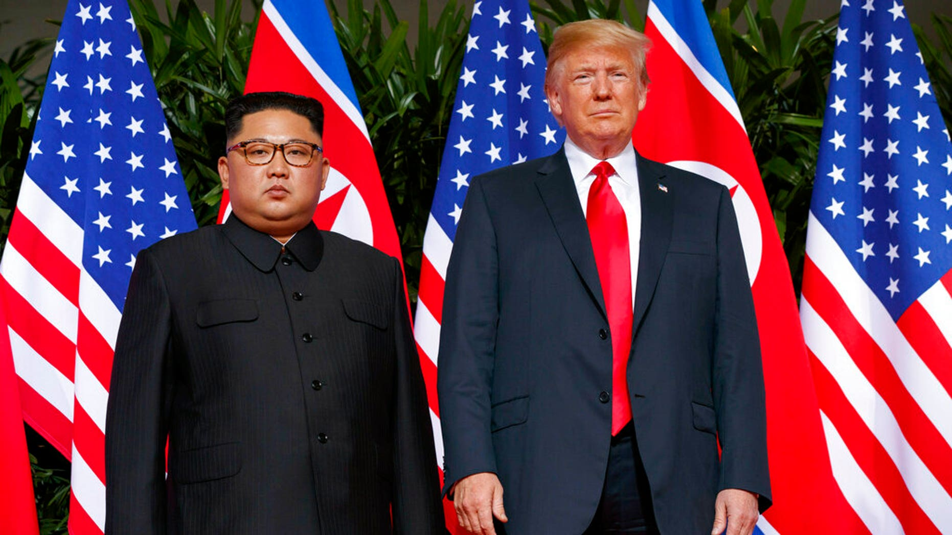 In this June. 12, 2018, file photo, U.S. President Donald Trump, right, meets with North Korean leader Kim Jong Un on Sentosa Island, in Singapore. A second summit between President Trump and North Korean leader Kim Jong Un will take place next month, the White House announced Friday. <br>