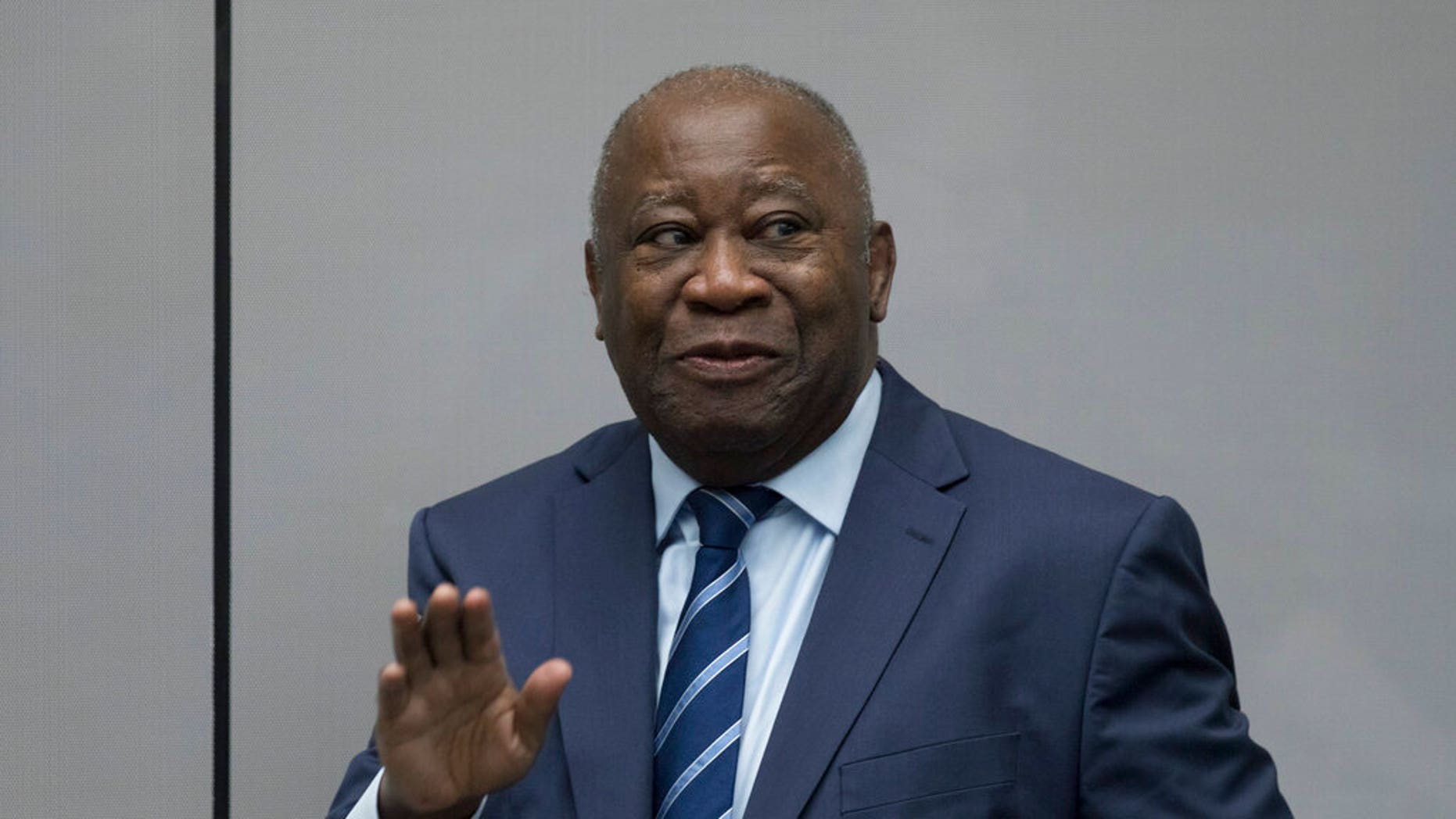 Former Ivory Coast President Laurent Gbagbo enters the courtroom of the International Criminal Court in The Hague, Netherlands, Tuesday, Jan. 15, 2019