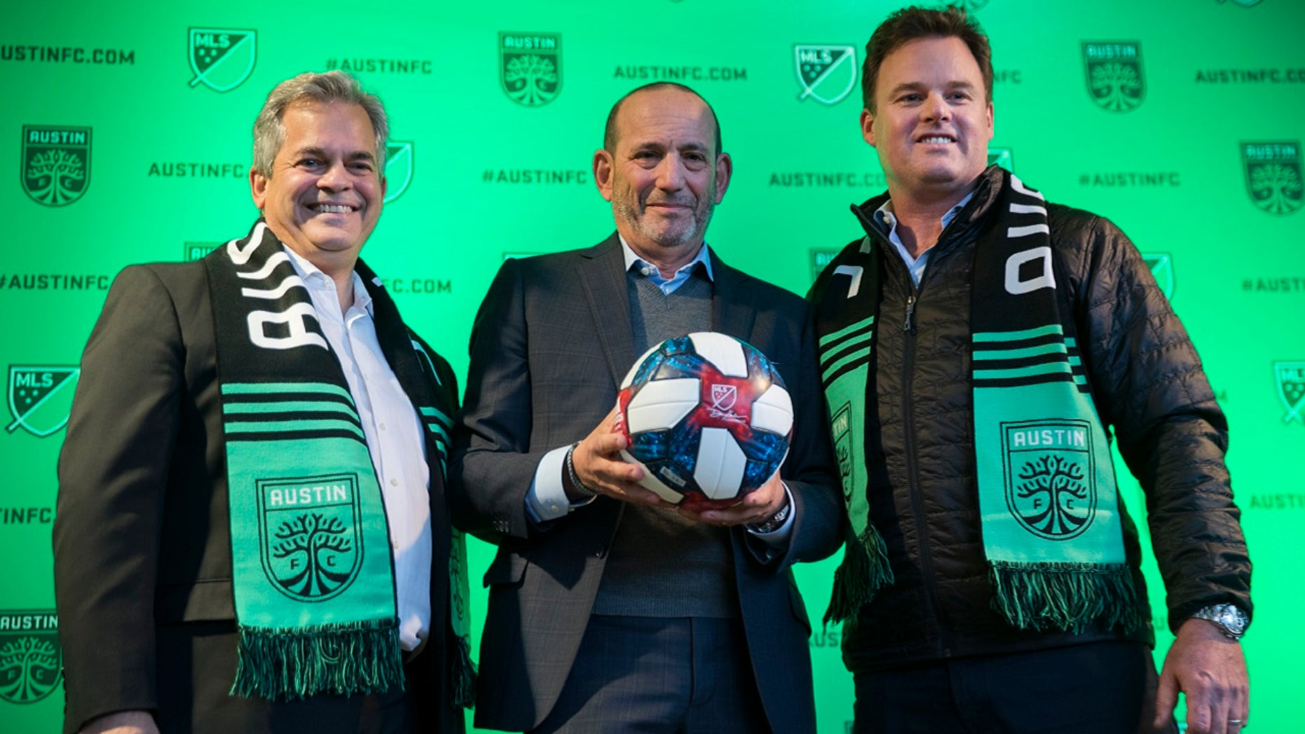 Austin Mayor Steve Adler, left, Major League Soccer Commissioner Don Garber and Austin majority owner Anthony Precourt, after the official announcement that Austin will be an expansion franchise for the 2021 season, Tuesday, Jan. 15, 2019 in Austin, Texas.