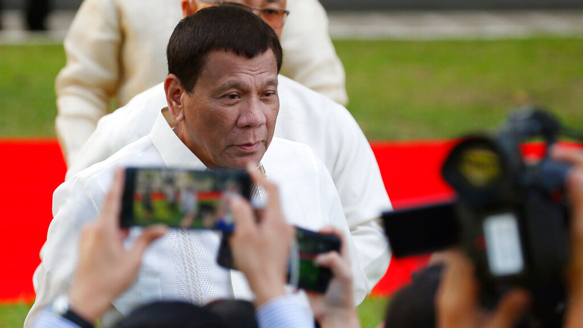 Philippine President Rodrigo Duterte talks to the media prior to a welcome ceremony for visiting Sri Lankan President Maithripala Sirisena Wednesday, Jan. 16, 2019, at the Presidential Palace grounds in Manila, Philippines.