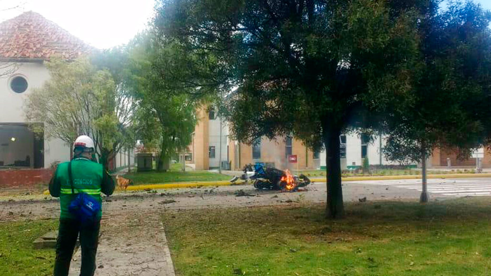 In this image provided by military personnel flames rise from a deadly car bombing at a police academy on Thursday Jan. 17 2019 in Bogota Colombia