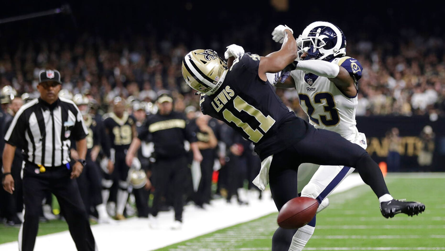 Saxon receiver Tommylee Lewis (11) works for a coach against Los Angeles Rams defender Nickell Robey-Coleman (23) during the second half of the NFL football NFC championship game Sunday.
