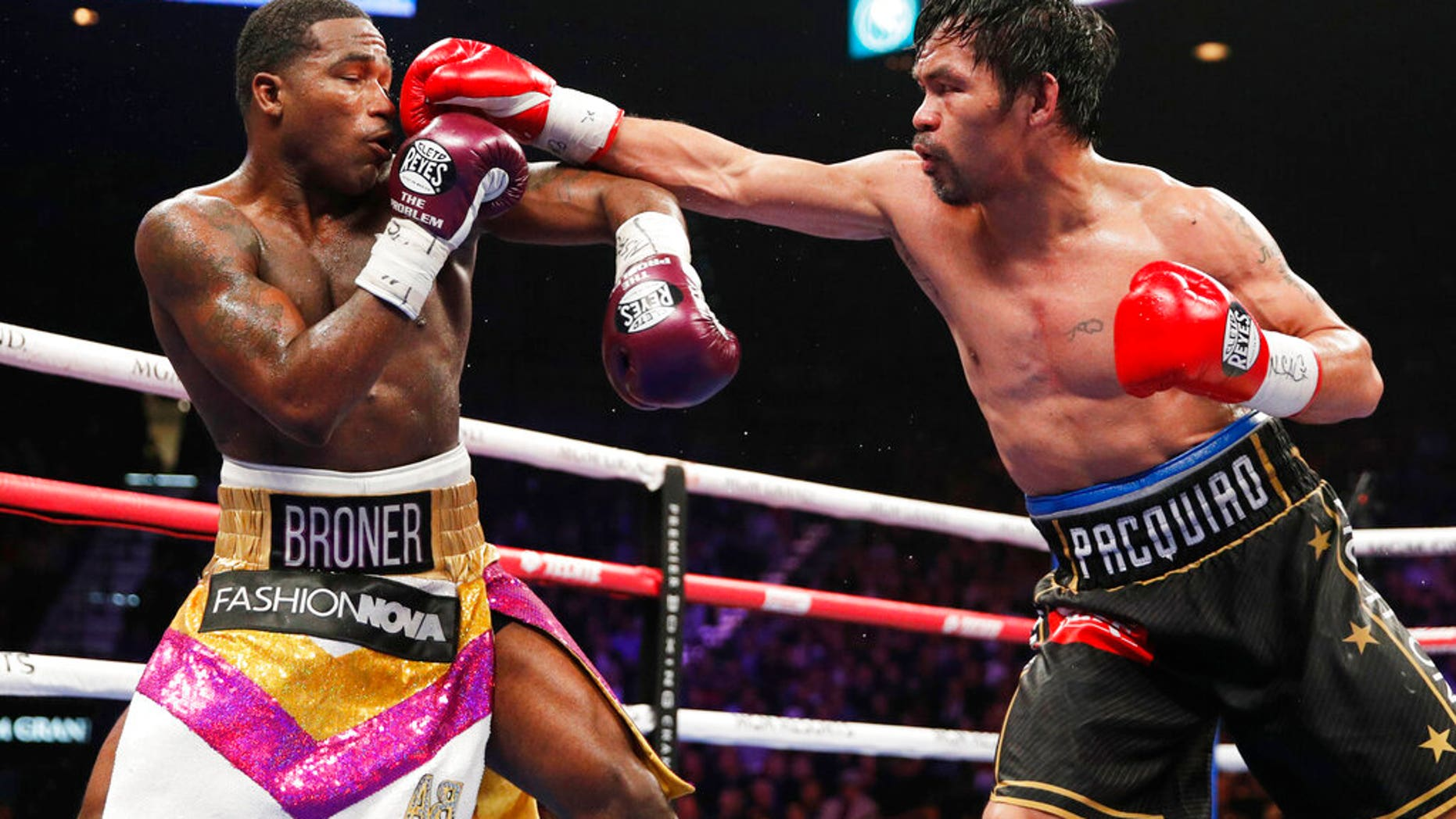 Manny Pacquiao, right, fights Adrien Broner in a welterweight championship bout in Las Vegas.
