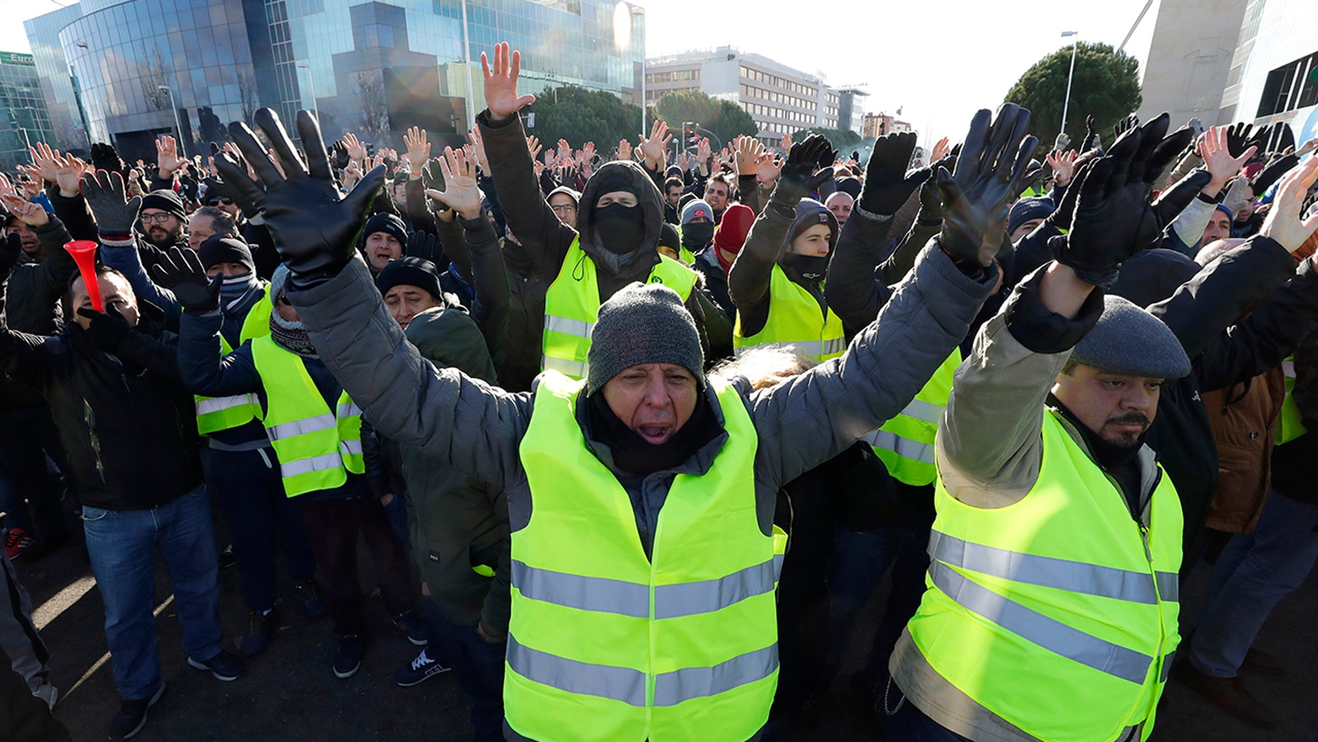 Striking Spanish taxi drivers demand more regulations for app-based ride-hailing services and are blocking access to a trade exhibition center in Madrid where a major tourism fair begins Wednesday.