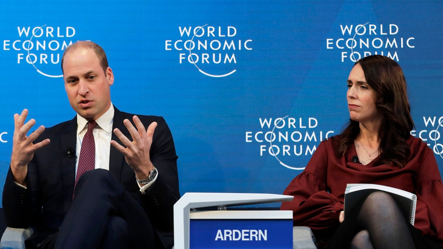 "Jacinda Ardern, Prime Minister of New Zealand, listens as Britain's Prince William speaks while taking part in the ""Mental Health Matters"" panel discussion at the annual meeting of the World Economic Forum in Davos, Switzerland, Wednesday, Jan. 23, 2019."