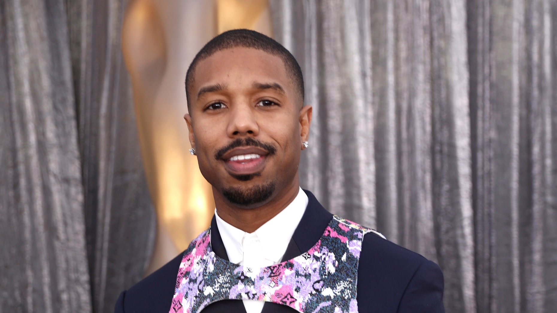 "Michael B. Jordan arrives at the 25th annual Screen Actors Guild Awards in Louis Vuitton ""harness."""