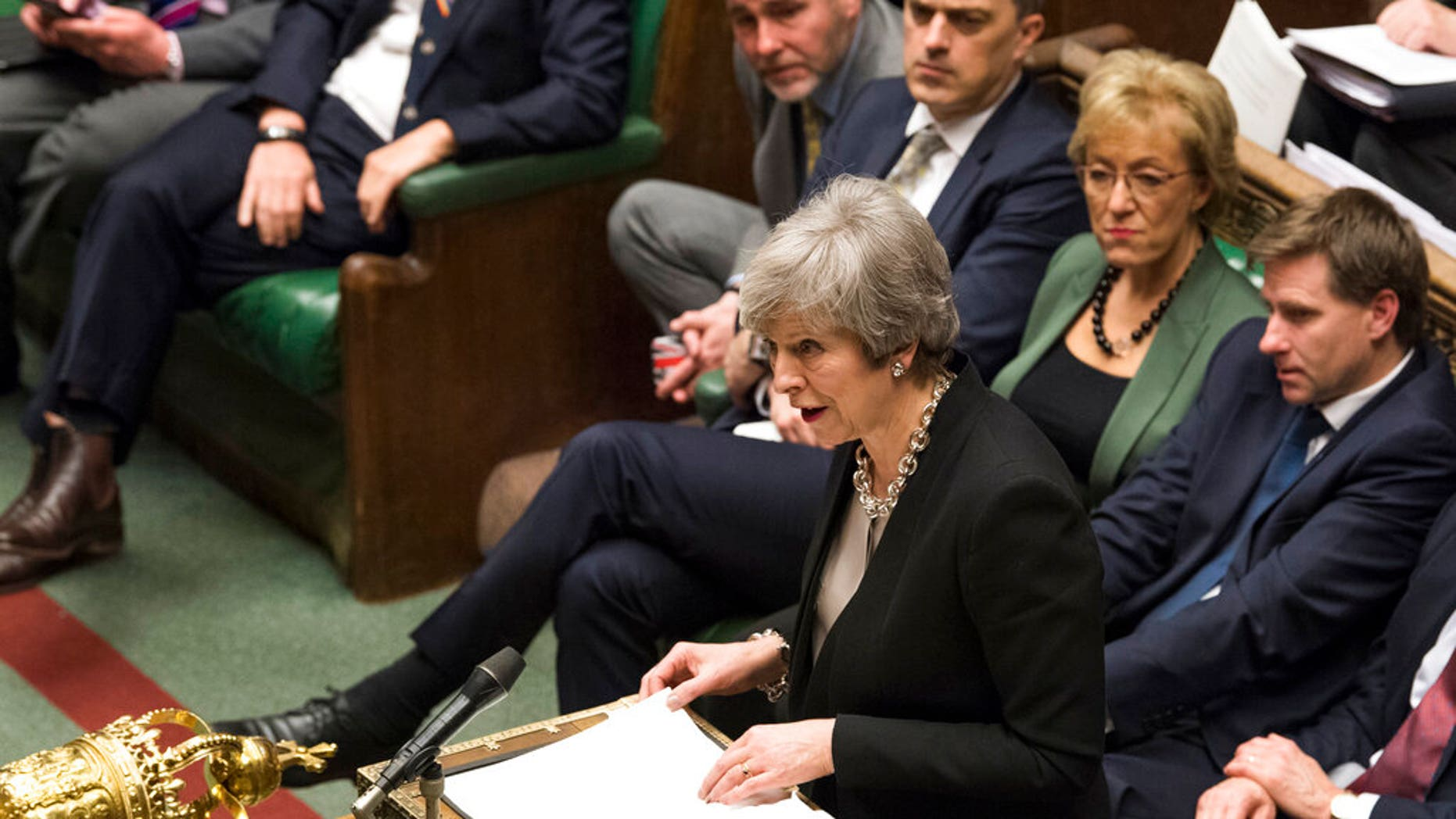 Britain's Prime Minister Theresa May reacts as she addresses the H  ouse of Commons Parliament during the debate on Britain's Brexit European Union Withdrawal Act, in London, Tuesday Jan. 29, 2019.(Jessica Taylor/UK Parliament via AP)