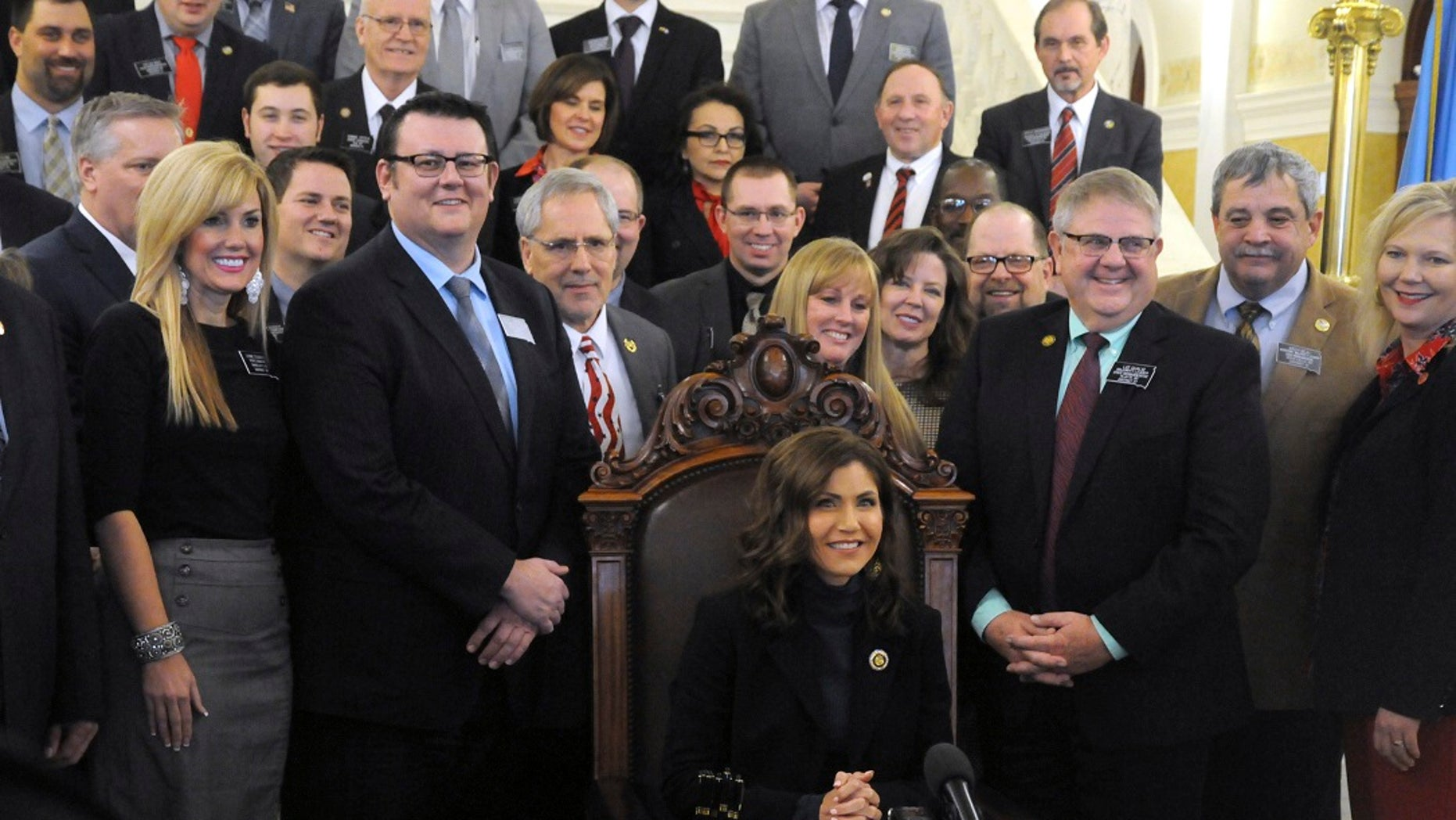 Gov. Kristi Noem smiles after signing her first bill into law at the state Capitol in Pierre, S.D., Thursday, Jan. 31, 2019. The measure allows people to carry concealed pistols without a permit in the state. (Associated Press)