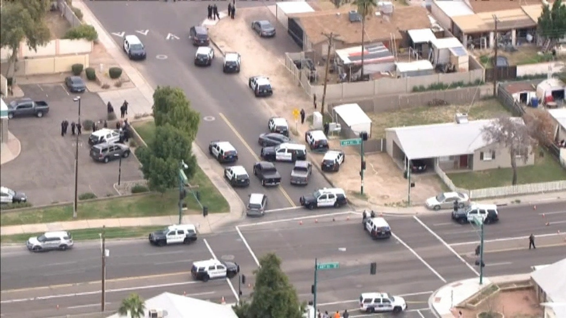 A burglary suspect shot to death by an officer Tuesday was a 14-year-old boy carrying a replica gun, police in Arizona said.