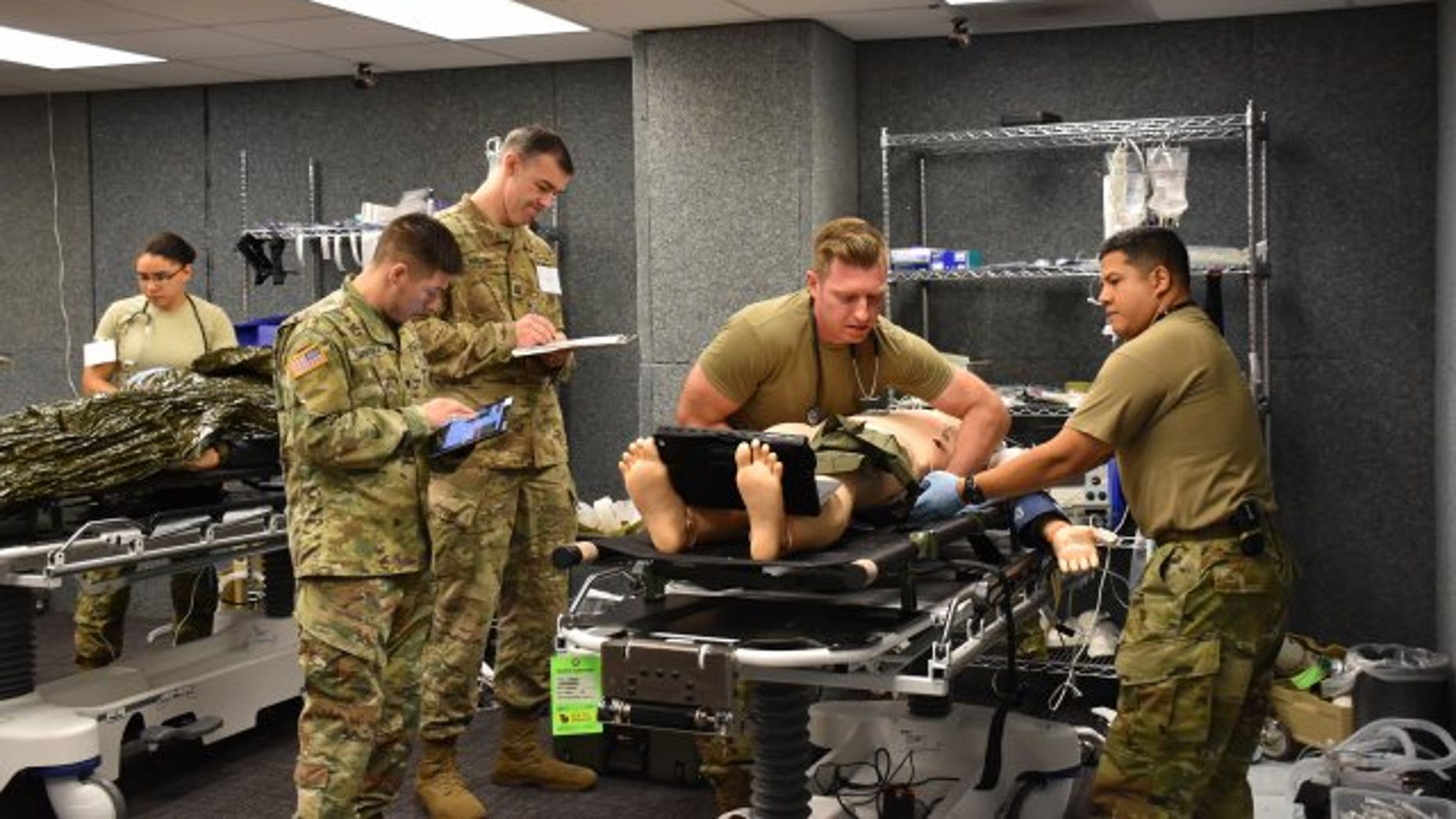 Army Cpt. Sean McCoy, 541st Forward Surgical Team ER physician, conducted patient evaluations on each injured soldier during training .