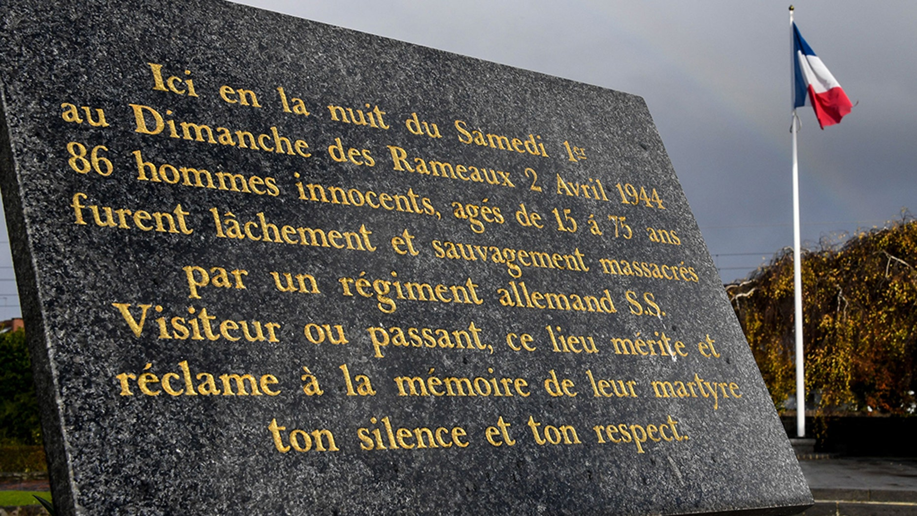 A commemorative plaque is pictured on November 13, 2017 in Villeneuve-d'Ascq, northern France, reminding of the April 2, 1944 WWII massacre of 86 civilians by a Nazi Germany regiment. After a 1949 trial that ended with the acquittal in 1955 of 17 Nazi SS officers and soldiers, victims' relatives are hoping a trial could be re-opened by Germany's legal system.