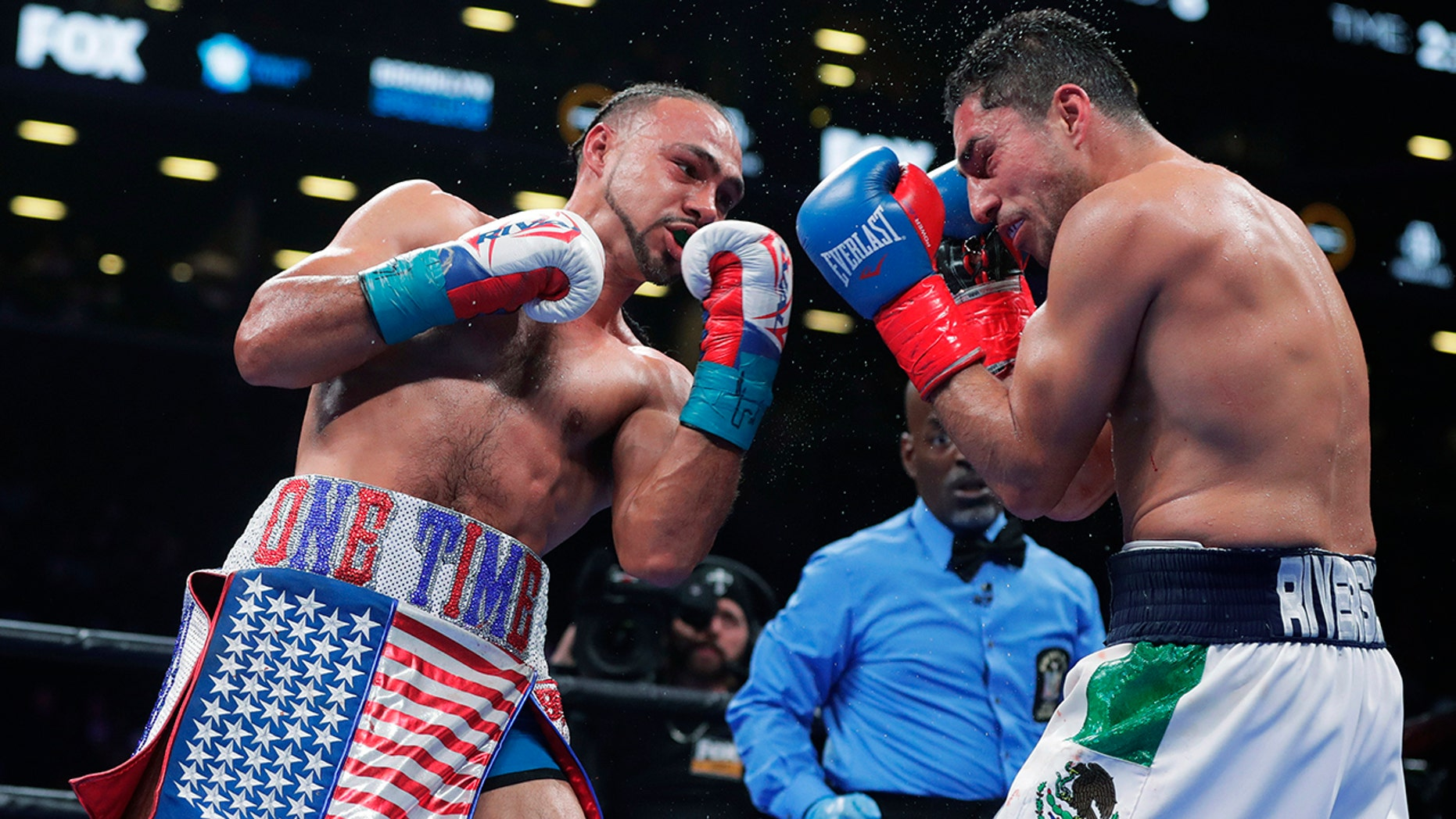 Keith Thurman and Jaime Munguia retain titles with decision wins