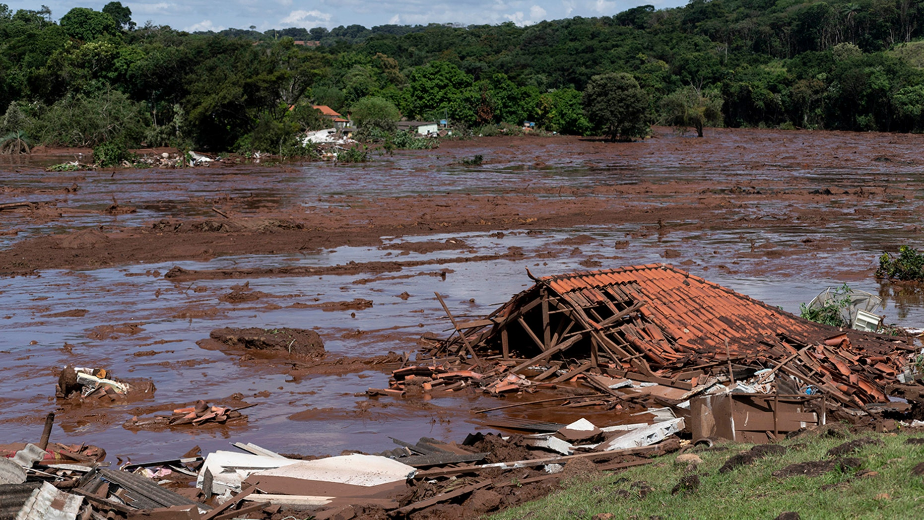 A structure is in ruins after a dam collapsed near Brumadinho, Brazil, Friday, Jan. 25, 2019. (Leo Drumond/Nitro via AP)