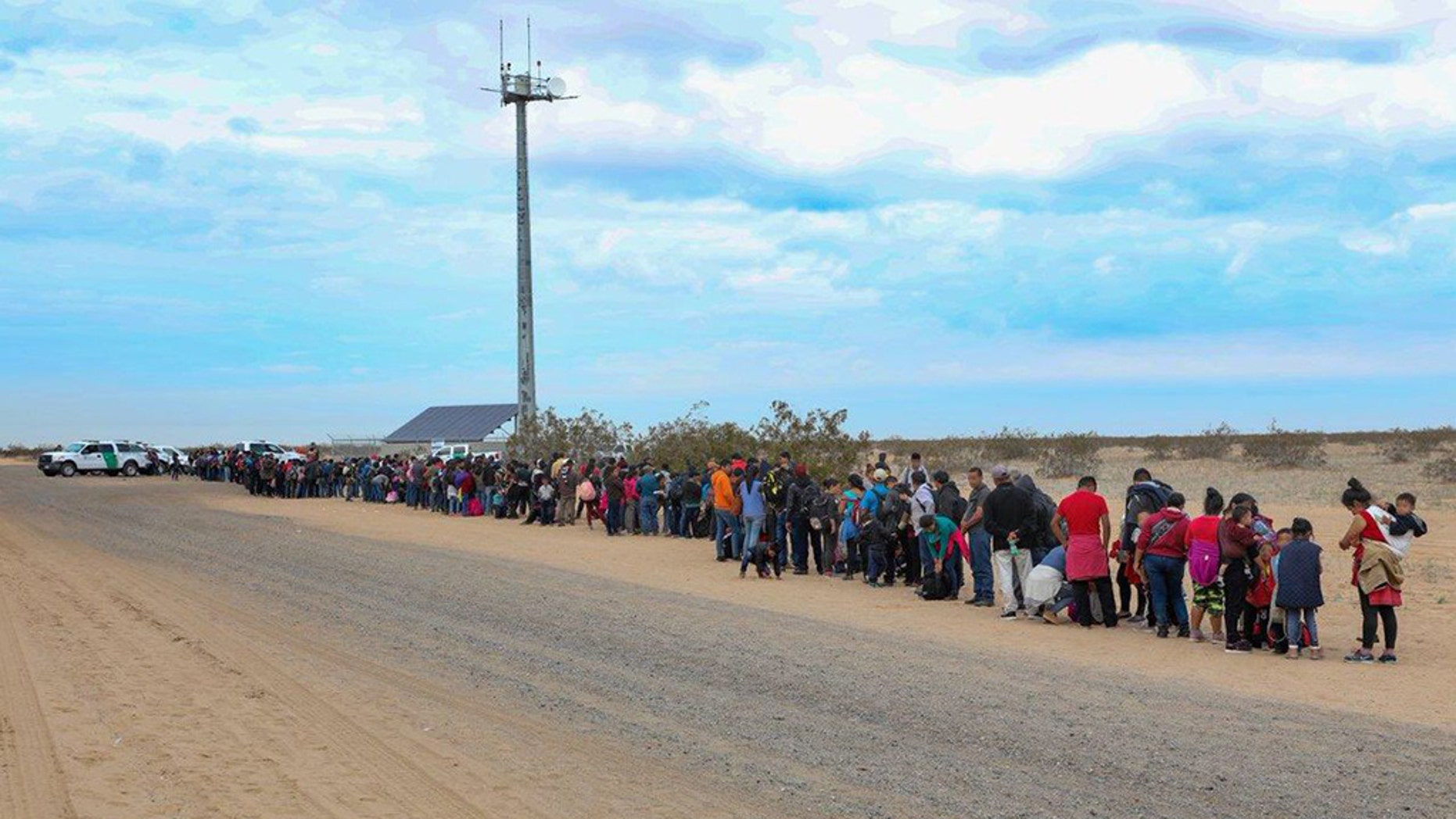 A group of 376 Central Americans reportedly made their way into the U.S. at the Arizona border this week by using short holes that were dug beneath the barrier, according to Border Patrol.