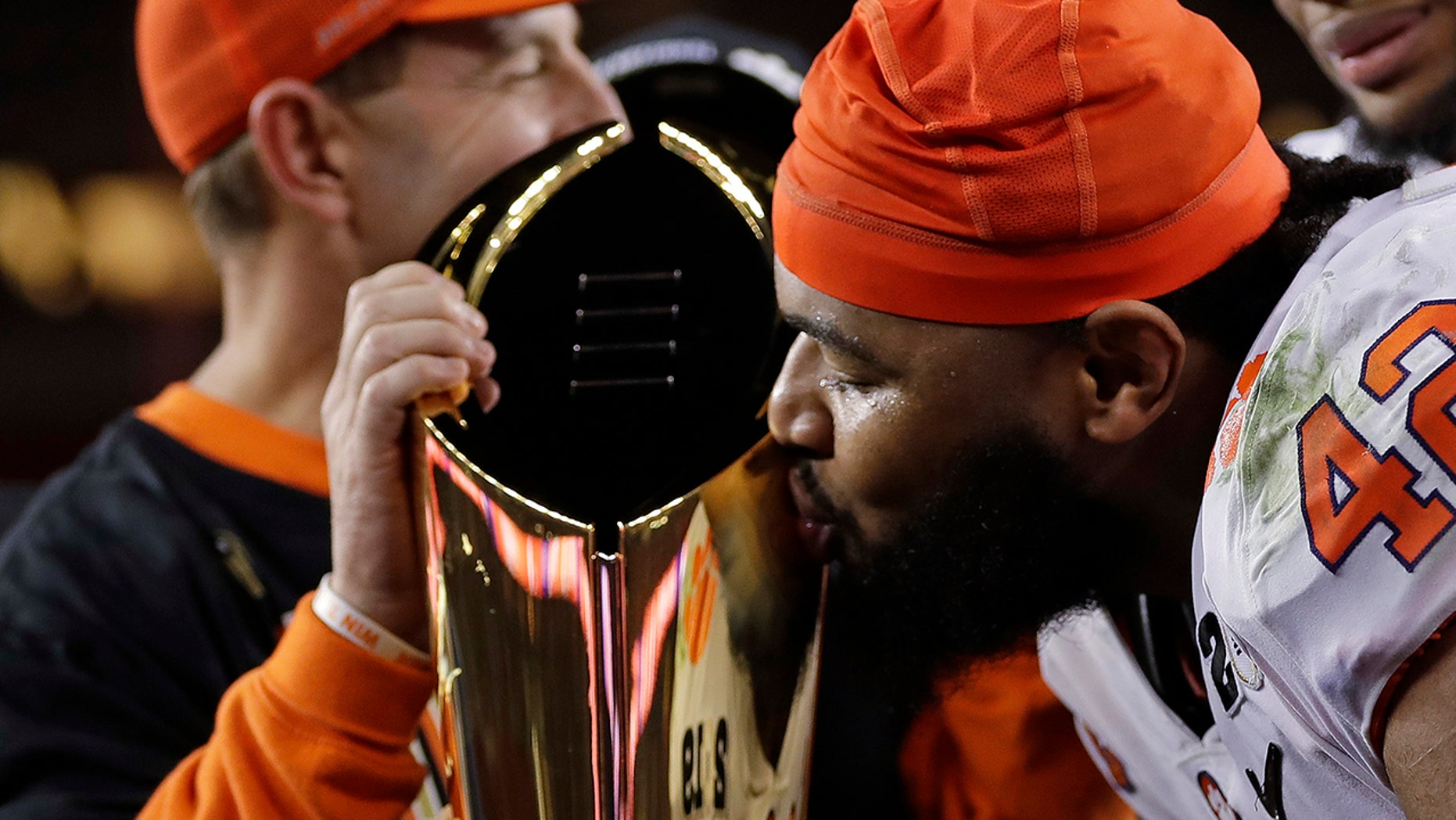Clemson's Christian Wilkins kisses the trophy after the NCAA college football playoff championship game against Alabama, Monday, Jan. 7, 2019, in Santa Clara, Calif. Clemson beat Alabama 44-16.