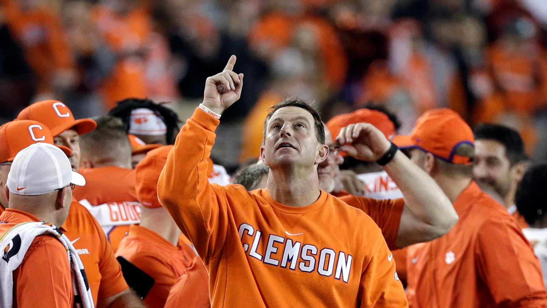 Clemson head coach Dabo Swinney celebrates in the final seconds of the NCAA college football playoff championship game against Alabama, Monday, Jan. 7, 2019, in Santa Clara, Calif. (AP Photo/David J. Phillip)