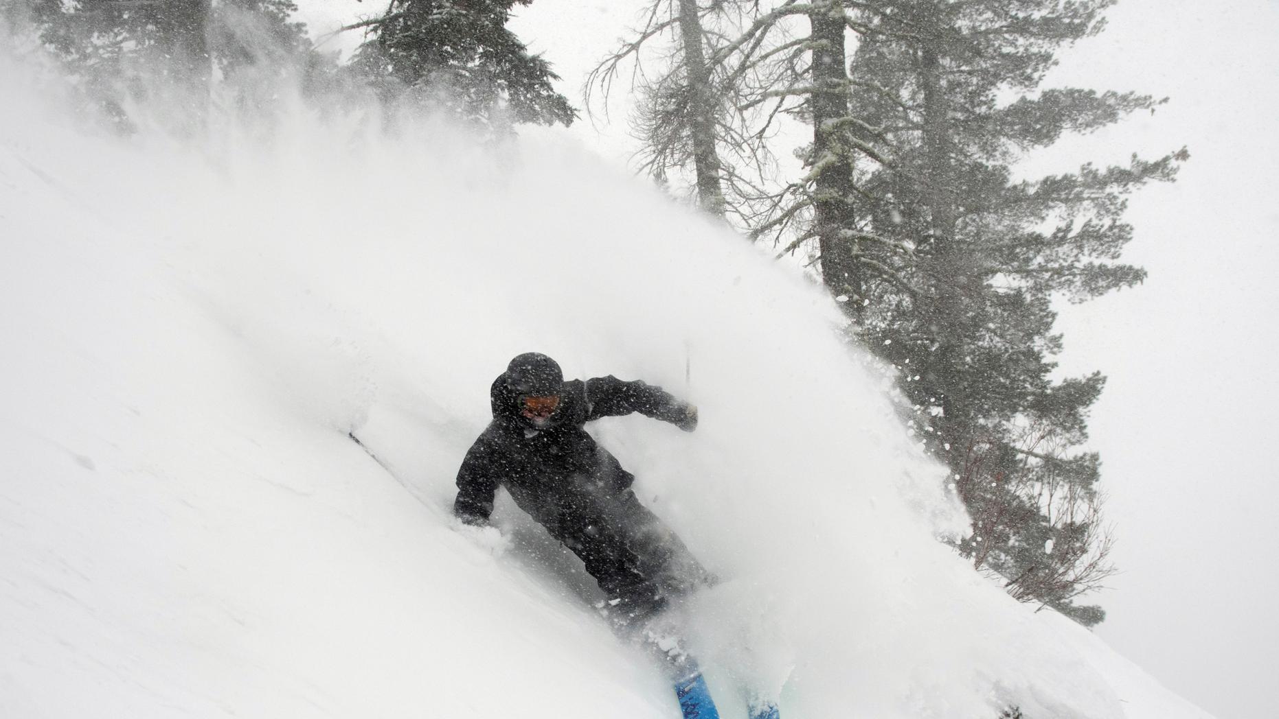 In this photo provided by Blake Kessler, Wesley Kepke skis in Alpine Meadows, Calif., on Sunday, Jan. 6, 2019. A winter storm swept through parts of California, Nevada and Utah, bringing heavy snow to some communities. (Blake Kessler via AP)