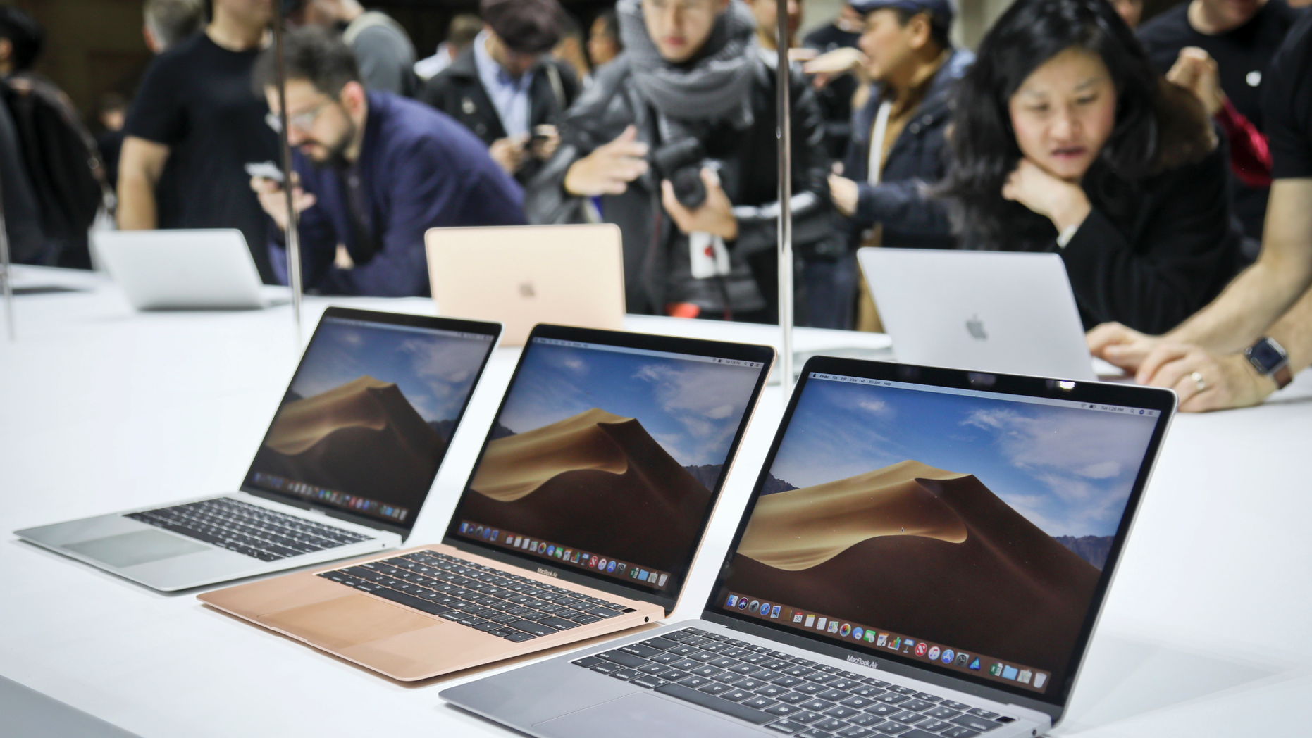 FILE- In this Oct. 30, 2018, file photo Apple's new MacBook Air computers are displayed during the company's showcase of new products in the Brooklyn borough of New York. (AP Photo/Bebeto Matthews, File)