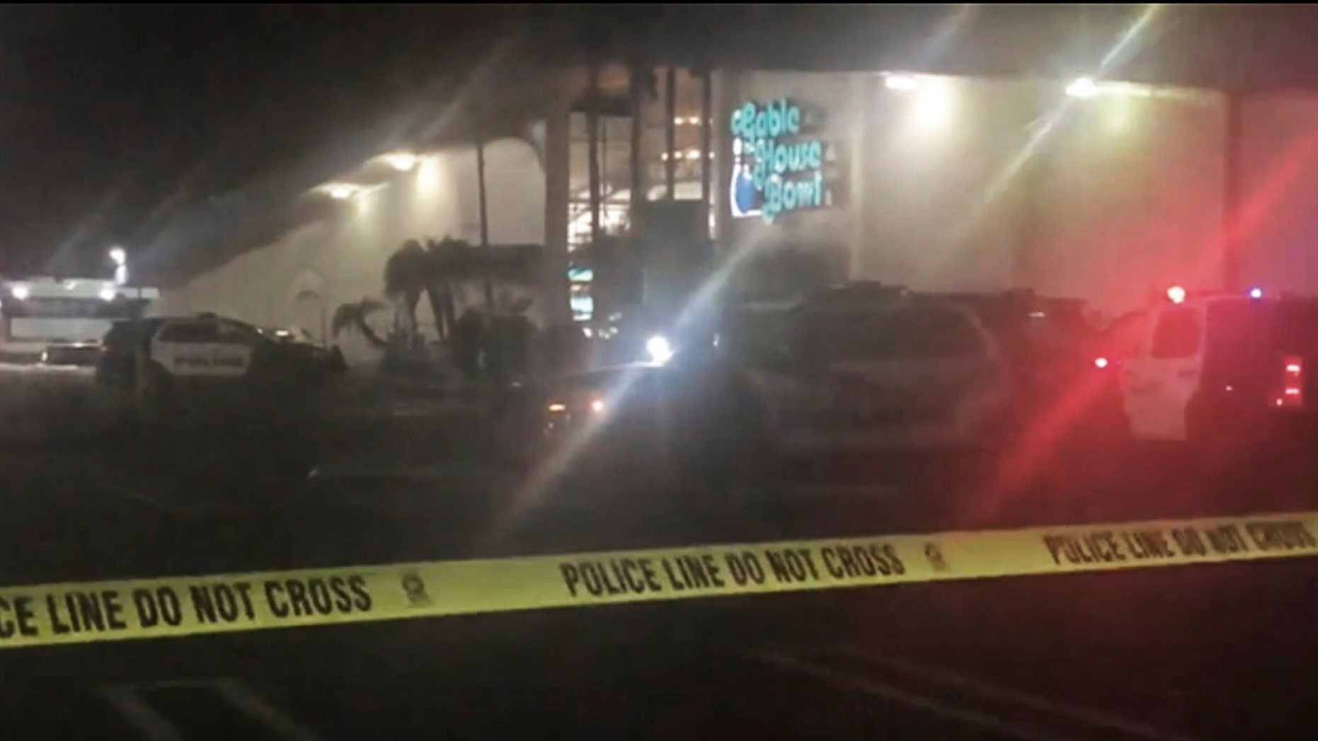 """Police rope off the scene of a shooting at a bowling alley in Torrance, Calif., early Saturday, Jan. 5, 2019.  The Torrance Police Department responded to calls of """"shots fired"""" at the Gable House Bowl shortly before midnight, Friday. Multiple victims were found with gunshot wounds inside the bowling ally, which is described on its website as a gaming venue that offers bowling, laser tag and a full arcade.  (AP Photo/APTN)"""