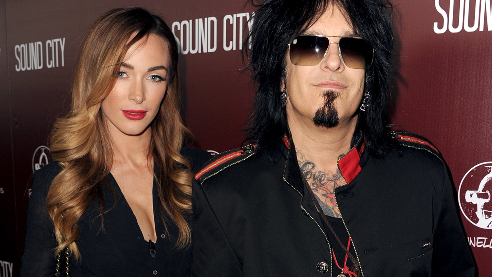 "Musician Nikki Sixx (L) and Courtney Bingham arrive at the premiere of ""Sound City"" at ArcLight Cinemas Cinerama Dome on January 31, 2013 in Hollywood, California."