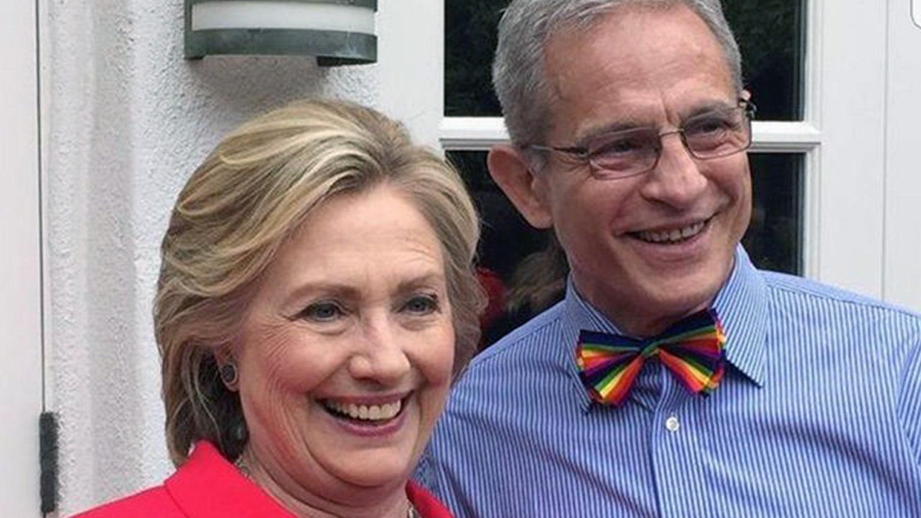 Ed Buck, right, poses with Hillary Clinton