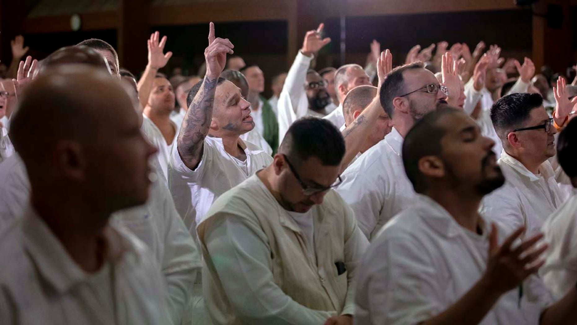Inmates at the Coffield Unit, a maximum security prison in Anderson County, Texas, worship during a church service. They are part of the newest campus for Gateway Church of Dallas, Texas.