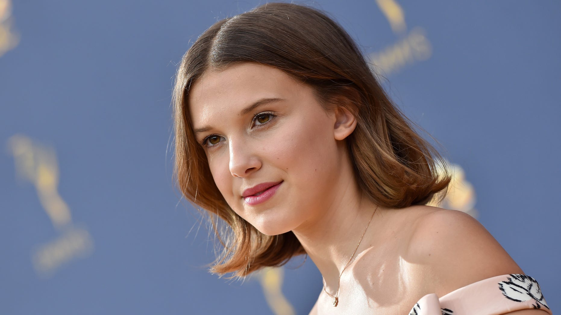 Millie Bobby Brown strike behind during people who pronounced she should act your age after she posted a print of herself wearing a midi dress.