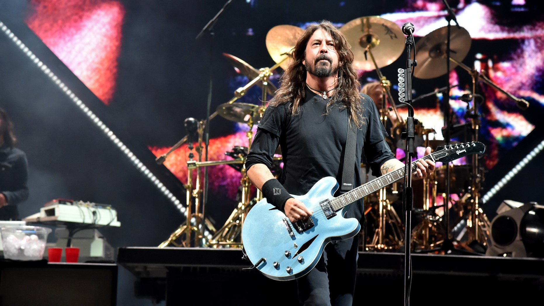 Foo Fighters frontman Dave Grohl fell off the stage after chopping a beer in front of the audience at a new concert.