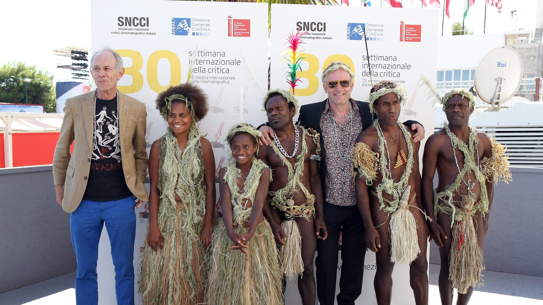 (L-R) Director Martin Butler, Marie Wawa, Marceline Rofit, Lingai Kowia, director Bentley Dean, Mungau Dain and Jimmy Jospeh Nako attend a photocall for 'Tanna' during the 72nd Venice Film Festival. It was reported that Dain has died.