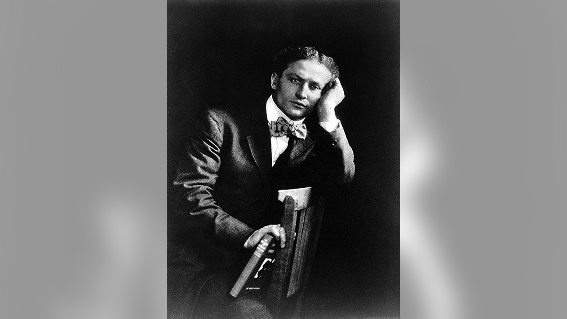 Magician Harry Houdini poes for a portrait in 1908.