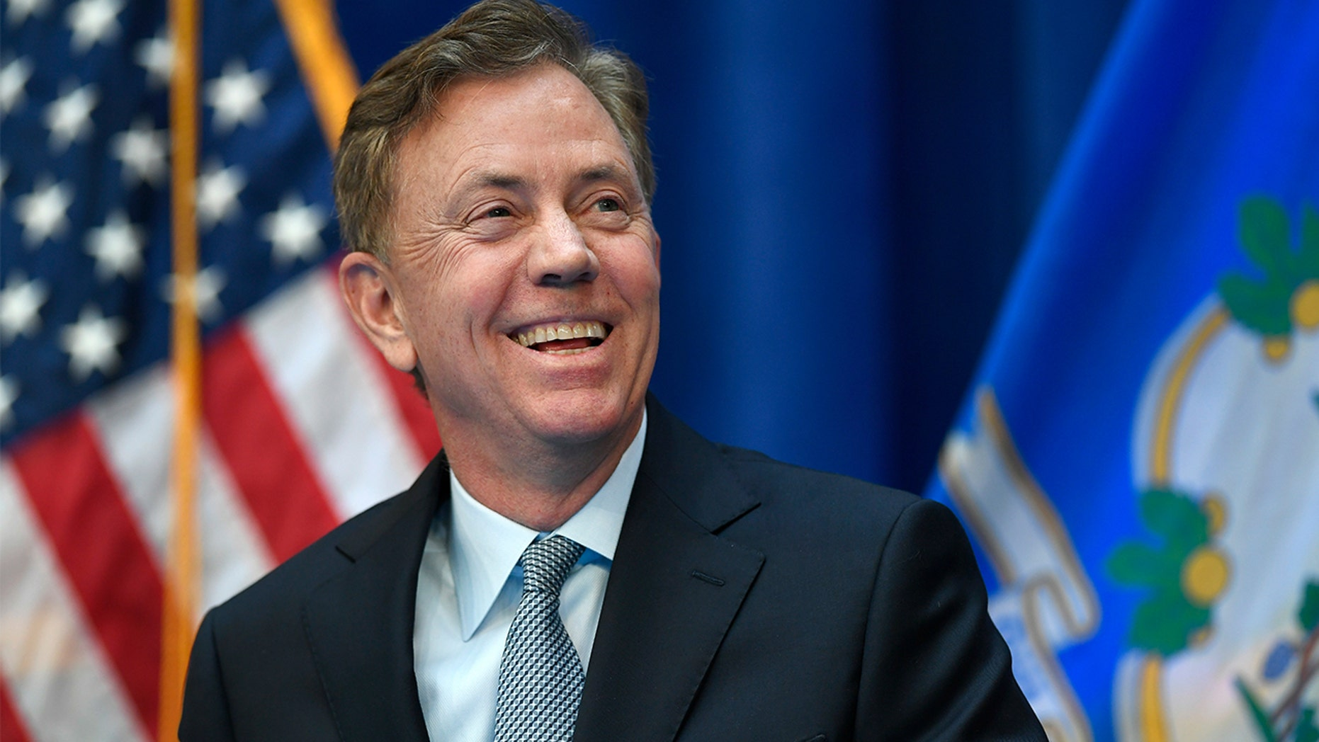 Connecticut Gov. Ned Lamont smiles during his inauguration, Wednesday, Jan. 9, 2019, inside the William A. O'Neill Armory in Hartford Conn. (AP Photo/Jessica Hill, Pool)