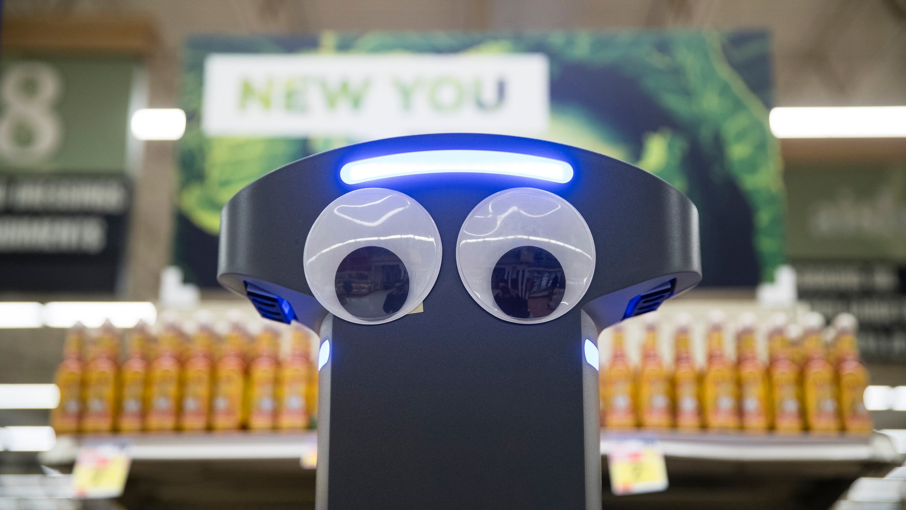 A robot named Marty cleans the floors at a Giant grocery store in Harrisburg, Pa., Tuesday, Jan. 15, 2019. (AP Photo/Matt Rourke)
