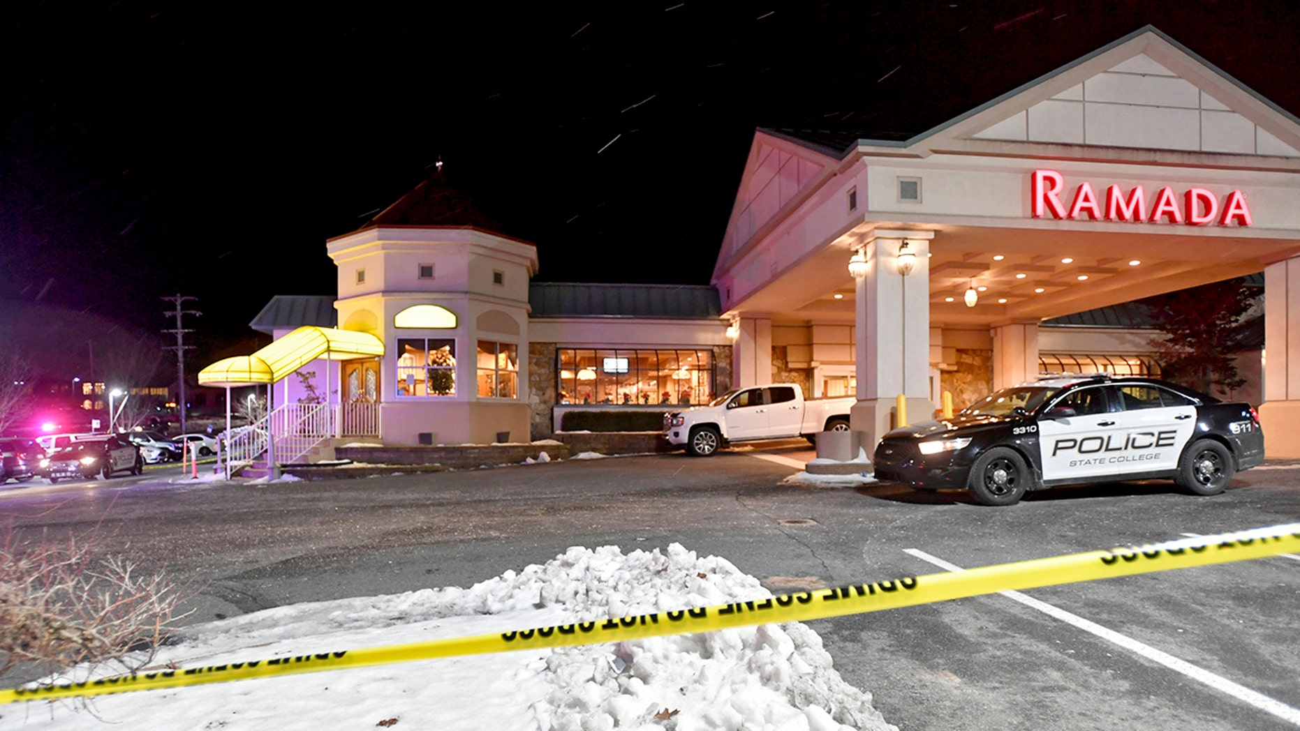 State College Police responded to a shootout at PJ Harrigan's Bar & Grill at the Ramada Inn Thursday, January 24, 2019, at State College, Pennsylvania (Abby Drey / Center Daily Times via AP)