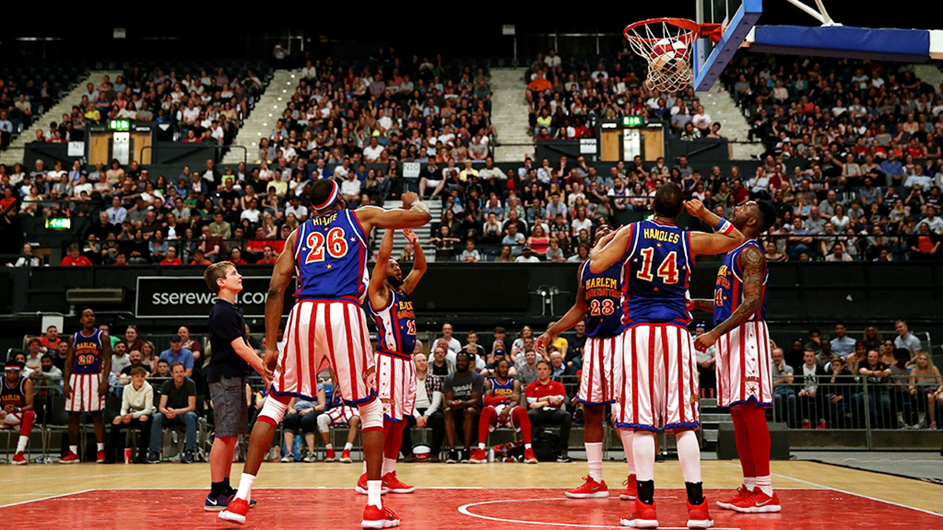 A spectator gets involved during The Original Harlem Globetrotters Tour at The SSE Arena, London. (Photo by Steven Paston/PA Images via Getty Images)