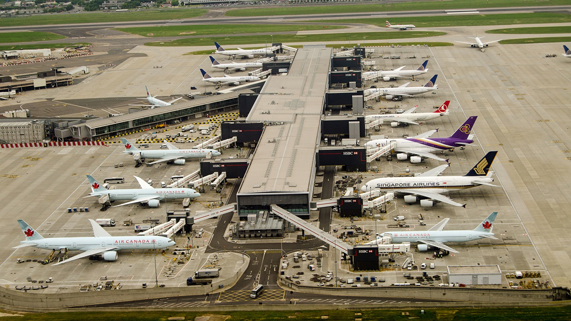 An aerial view of London Heathrow Airport in 2016. Departing flights were temporarily grounded there Tuesday after a report of a drone sighting.