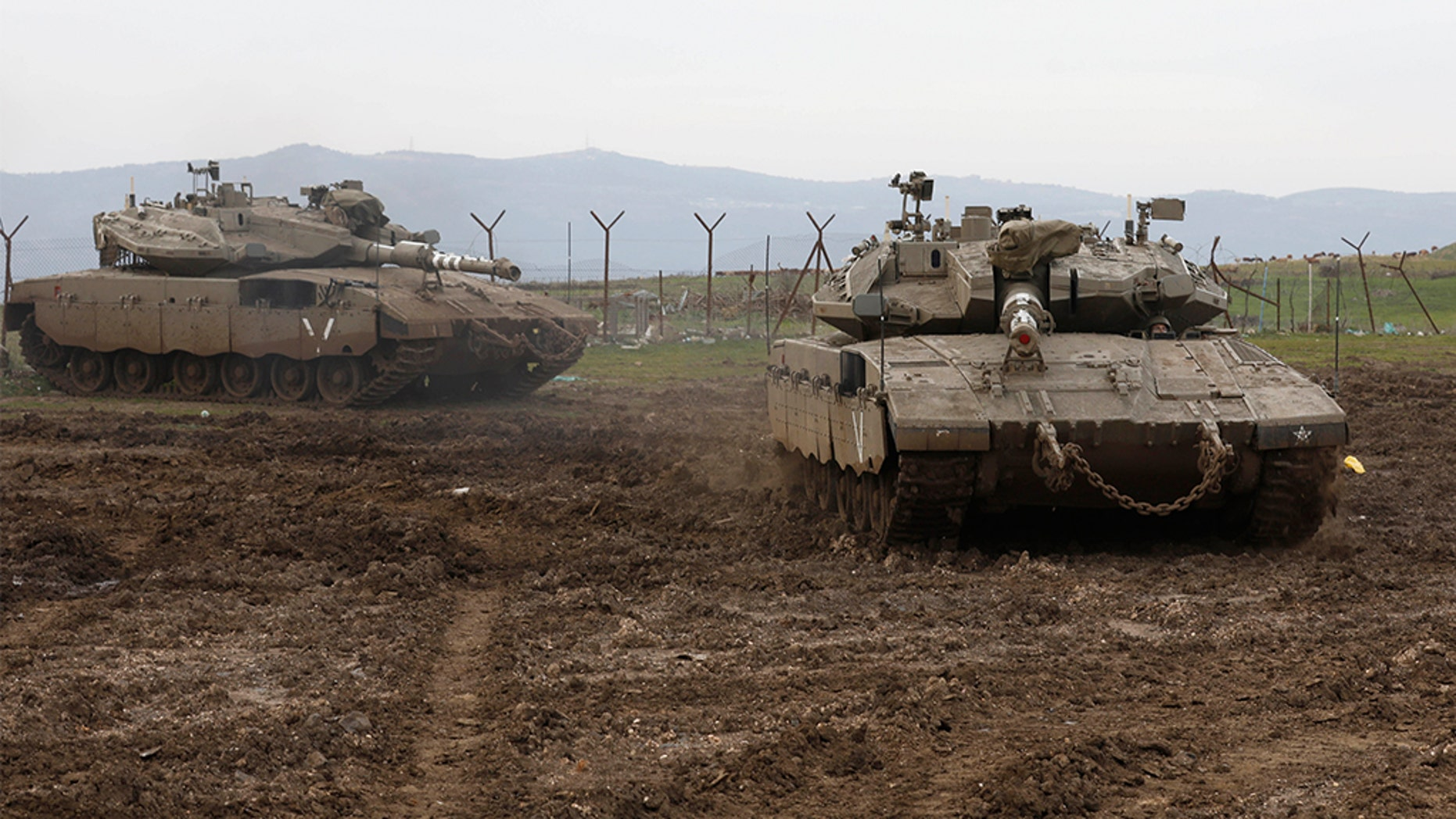 Israeli army Merkava tanks gather in the Israeli-annexed Golan Heights, on January 20, 2019. (Photo by JALAA MAREY / AFP) (Photo credit should read JALAA MAREY/AFP/Getty Images)