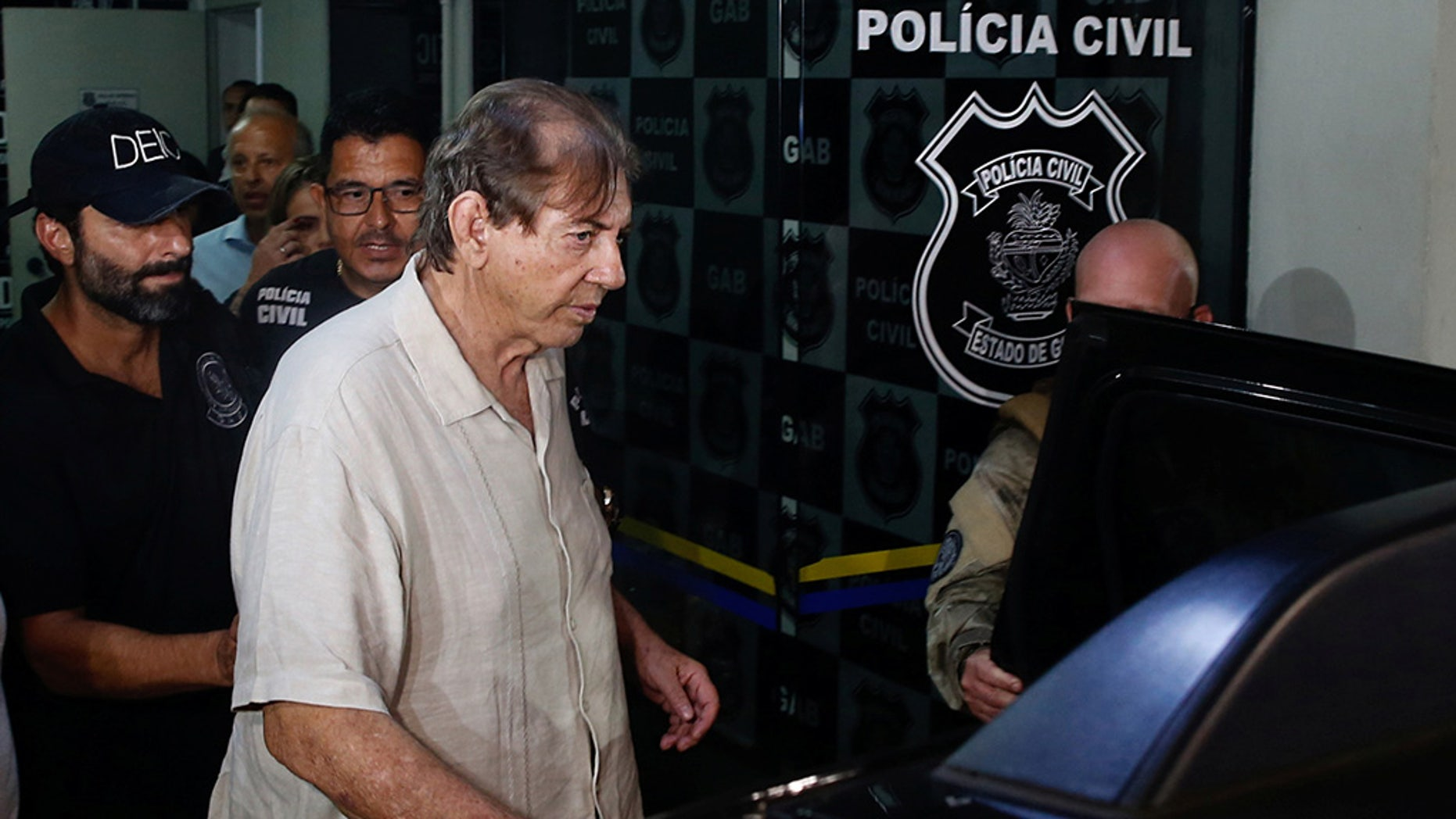 João Teixeira de Faria, who is known as João de Deus, or John of God, seen here in December, was charged with abusing four women while they were seeking spiritual guidance and treatment; a judge in Abadiânia, the small town in central Brazil where Faria's spiritual center is located, accepted the charges Wednesday. (REUTERS/Metropoles/Igo Estrela)