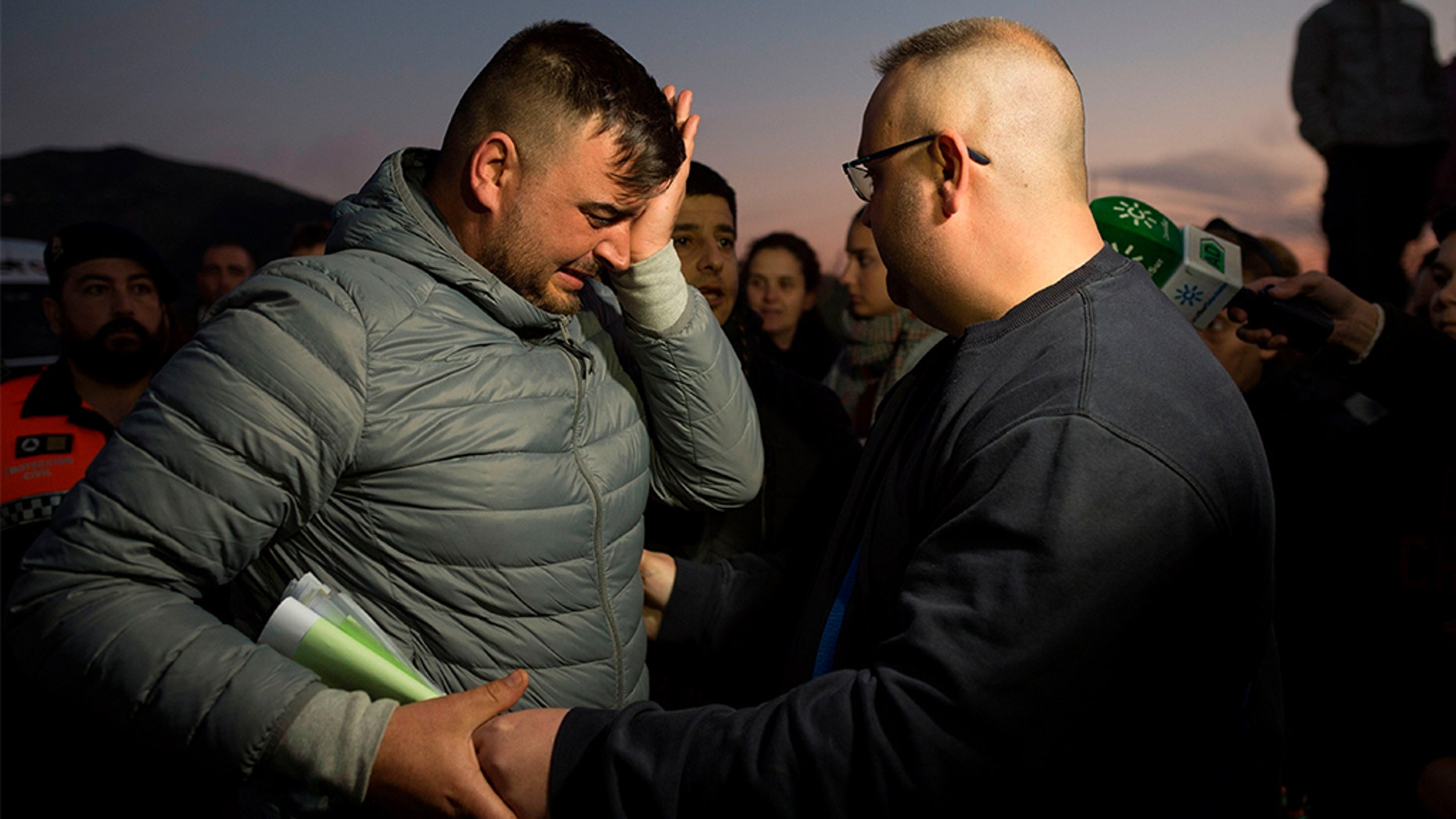 Jose Rosello (left), father of Julen who fell down a well, crying Wednesday as rescue efforts continue to find the boy in Totalan, southern Spain. (JORGE GUERRERO/AFP/Getty Images)