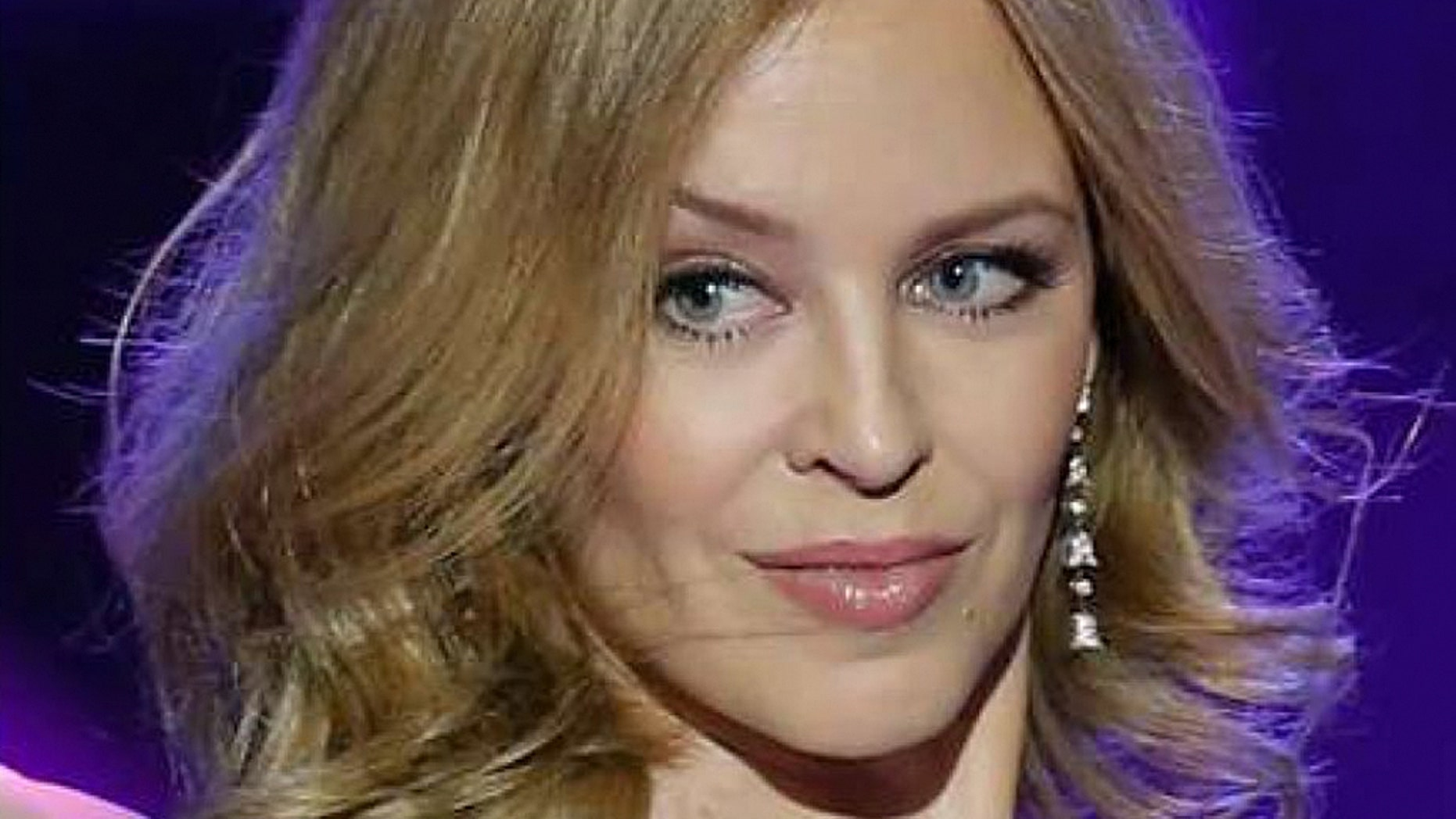 Kylie Minogue: Man warned after harassing pop star