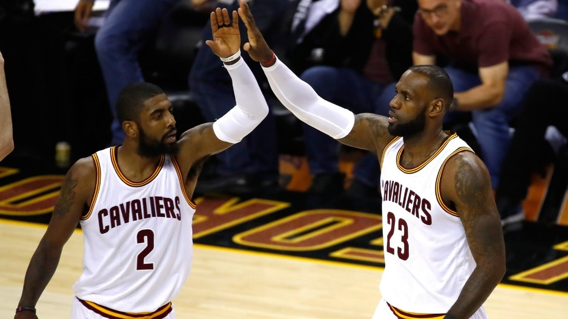 Kyrie Irving [left] said he called LeBron James [right] to apologize.