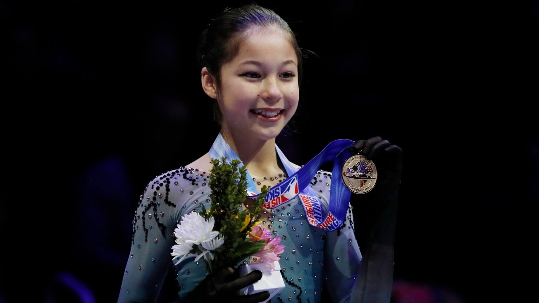 Alysa Liu holds her metal after winning the women's title during the U.S. Figure Skating Championships on Friday, Jan. 25, 2019.