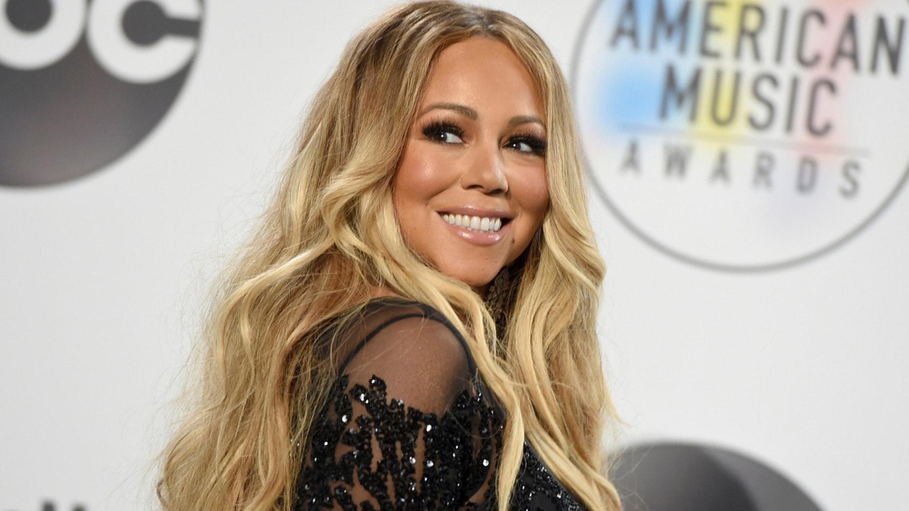 Singer Mariah Carey stunned in a sparkling string bikini.