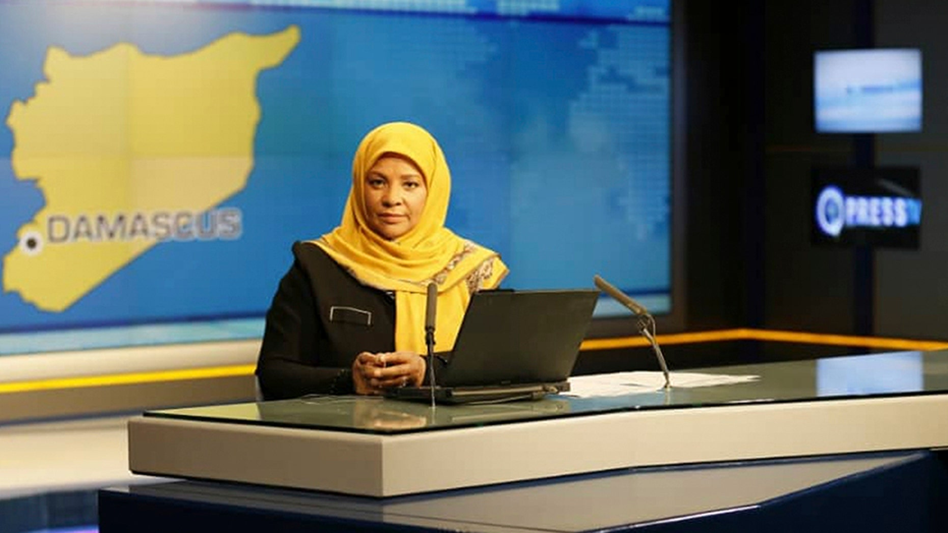 This undated photo provided by Iranian state television's English-language service, Press TV, shows American-born news anchor Marzieh Hashemi at studio in Tehran, Iran.