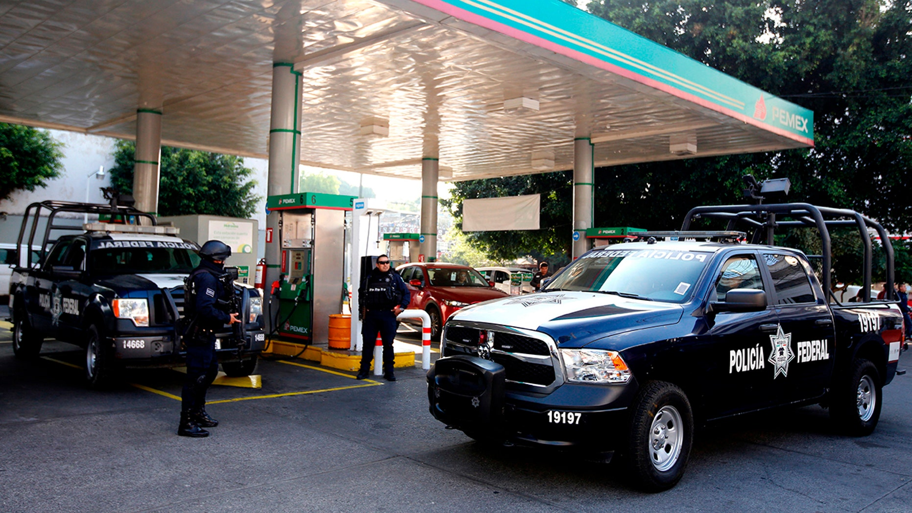 Federal police officers stand guard at a gas station in Guadalajara, Jalisco State, Mexico, on January 18, 2019. Mexican investigators opened a record number of murder cases the year prior, statistics show.