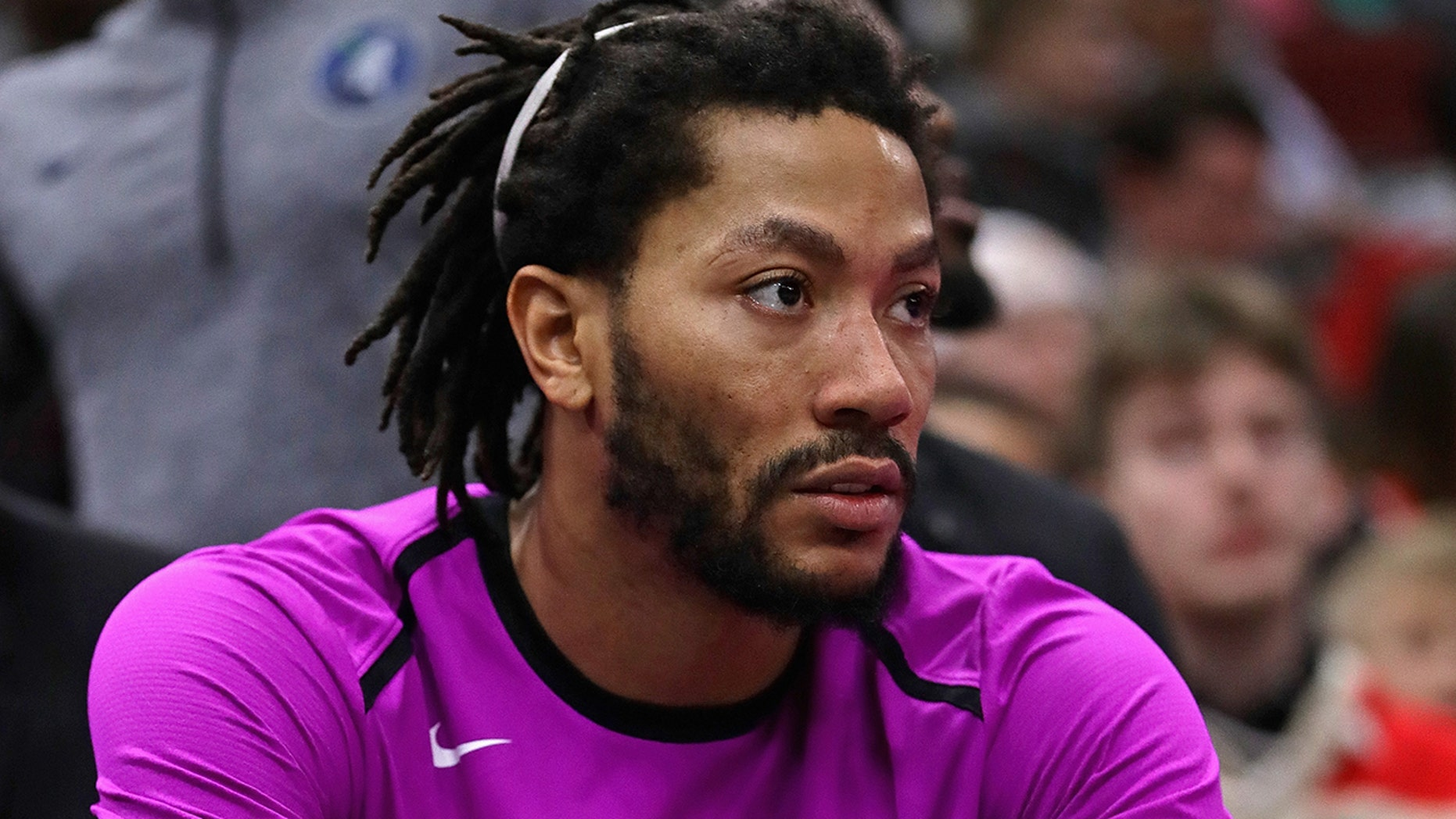 Derrick Rose #25 of the Minnesota Timberwolves watches from the bench as teammates take on the Chicago Bulls at the United Center on December 26, 2018 in Chicago, Illinois.